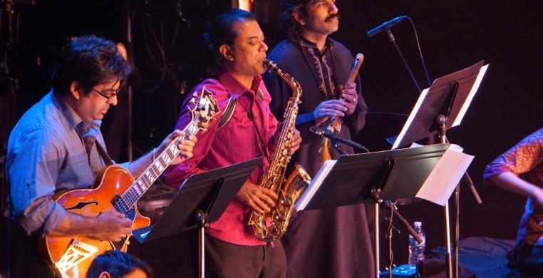The Song of the Jasmine Rajna Swaminathan (mridangam), Rez Abbasi (guitar), Rudresh Mahanthappa (saxophone)  V. K. Raman (South Indian flute) Photo: Praba Manivasagar