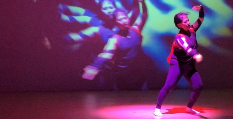 """A still from """"Beyond the Box, 4.3,"""" featuring performer Yoshinojo Fujima (pictured). Image courtesy of Asian Improv aRts Midwest"""