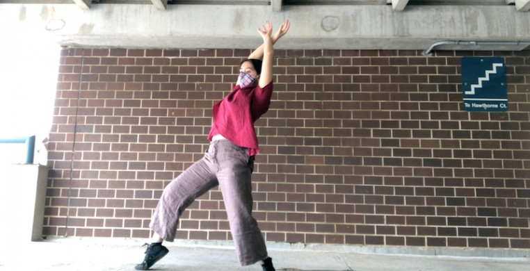 "Julianna Hom performing her solo ""AMERICANIZATION"" in a parking garage. Screen shot courtesy of the artist"