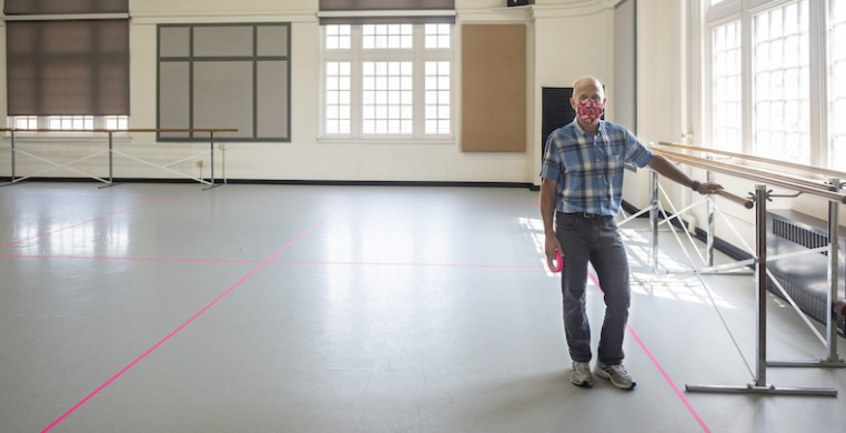 UW-Madison theatre director Claude Heintz takes a break from taping a studio floor. The dance department is taking extraordinary measures to make in-person college dance happen this fall. Photo by Maureen Janson Heintz.