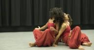 Unwinding Dancers Sitting back to back
