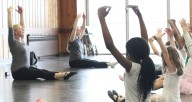 Ballet students stretch on the floor during Synapse Arts ballet class at Loyola Park