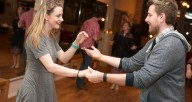 A couple swing dancing at Ballroom Dance Chicago